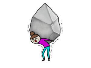 重い岩を背負った女性